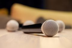 Closeup silver iron microphones with black handle on the table. Concept live music in restaurant, bar in the evening, sing in royalty free stock image