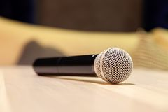 Closeup silver iron microphones with black handle on the table. Concept live music in restaurant, bar in the evening, sing in royalty free stock photography