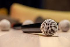 Closeup silver iron microphones with black handle on the table. Concept live music in restaurant, bar in the evening, sing in royalty free stock images