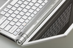 Closeup of silver laptop. Silver laptop in the open form, a fragment of the keyboard stock photos
