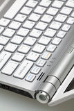 Closeup of silver laptop. Silver laptop in the open form, a fragment of the keyboard royalty free stock photography