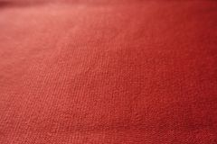 Closeup of simple orange jersey fabric. Closeup of simple unprinted orange jersey fabric Royalty Free Stock Photography