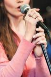 Closeup of singing caucasian woman stock image