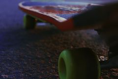 A closeup of a skateboard on the street stock photo