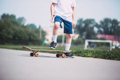 Closeup of skateboarder legs. Royalty Free Stock Photo