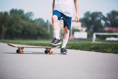Closeup of skateboarder legs. Royalty Free Stock Photography