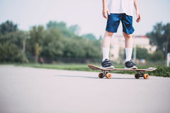Closeup of skateboarder legs. Stock Image