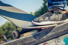 Closeup of skateboarder legs Stock Photos
