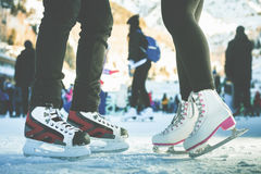 Closeup skating shoes ice skating outdoor at ice rink. Magical glitter of snowy snowflakes and bokeh. Healthy lifestyle and winter sport concept at sports Stock Photo