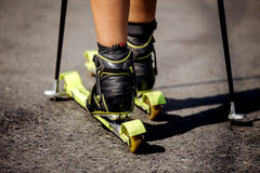 Closeup of ski rollers on legs of male athlete Stock Photography
