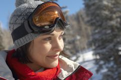 Closeup Of Skier Looking Away. Close up of happy beautiful skier looking away Royalty Free Stock Images
