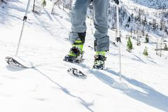 Closeup of skiing equipment. Skier standing on a snow Royalty Free Stock Photos