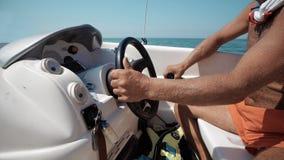 skippers hands turning steering wheel at sailing boat Royalty Free Stock Photos