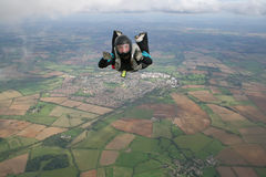 Closeup of skydiver in freefall. On a sunny day Stock Image