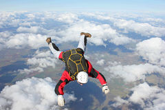 Closeup of skydiver in freefall. On a sunny day Royalty Free Stock Photography