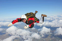 Closeup of skydiver in freefall. On a sunny day Stock Photo