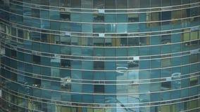 Closeup skyscraper glass windows reflect ,business buildings,global commerce. stock footage