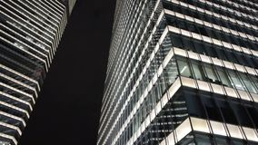 Closeup skyscraper at night,urban morden business buildings district. Office building at night in shanghai lujiazui finance center,urban morden business stock footage