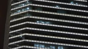 Closeup skyscraper at night,urban morden business buildings district. stock footage