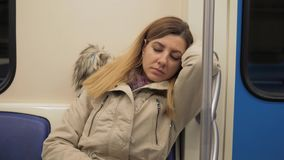 Closeup Of A Sleeping Caucasian Woman In A Warm Jacket In Train Subway