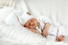 Closeup sleeping newborn baby on a blanket, in a white dress, place for text, top view, set royalty free stock images