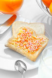 Closeup of a slice of bread with candies Stock Images