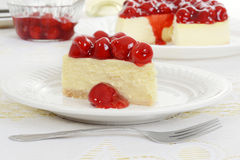Closeup Slice of cherry cheesecake Stock Images