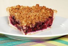 Closeup slice of fruit berry crumble pie royalty free stock photography
