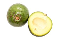 Closeup Slice of green thai avocado on white background. Close up Slice of green thai avocado on white background royalty free stock photography