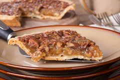 Slice of Pecan Pie. Closeup of a slice of pecan pie on a plate Royalty Free Stock Photo