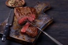 Closeup slice steak on board Stock Images