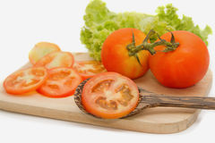 Closeup of slice tomato on Wooden  Board Royalty Free Stock Image