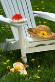 Closeup of slice of watermelon on adirondack chair Royalty Free Stock Photos
