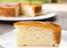 Sliced caramel custard cake on white plate. Sweet and moist dessert. Stock Photos