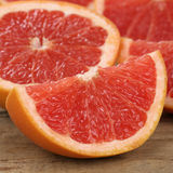 Closeup sliced grapefruit fruits Stock Images