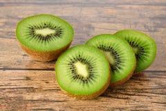 Closeup sliced kiwi fruit on wood table Royalty Free Stock Image