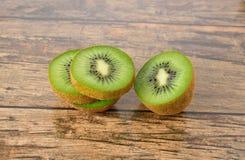 Closeup sliced kiwi fruit on wood table Stock Images