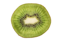 Closeup of a sliced kiwifruit isolated Stock Images