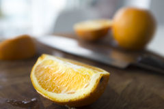 Closeup of Sliced Oranges with Knife Royalty Free Stock Images