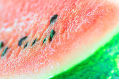 Closeup of sliced watermelon on wooden table Stock Photos