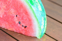 Closeup of sliced watermelon on wooden table Stock Photography