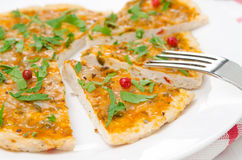 Closeup of slices of chicken pizza with tomato sauce, cheese Stock Photo