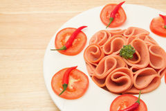 Closeup slices of ham on white  plate Stock Images