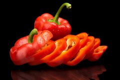 Free Closeup Slices Of Red Bell Peppers On Black With Drops Of Water Stock Images - 51677304