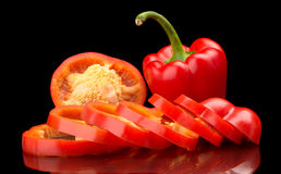 Closeup slices of red bell peppers isolated on black Royalty Free Stock Photo