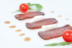 Closeup of slices of smoked tuna. royalty free stock image