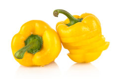 Closeup slices of yellow bell peppers on white with drops of water Royalty Free Stock Photos