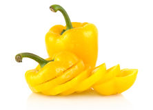 Closeup slices of yellow bell peppers on white with drops of water Stock Images