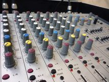 Closeup on a sliders of a mixing console. Stock Image