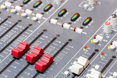 Closeup on sliders of sound mixing console in audio recording Stock Images